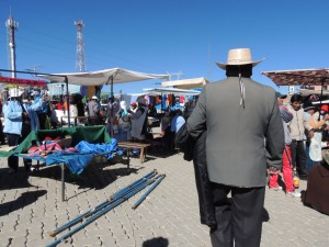 A Bolivian man walks through the El Alto markets.