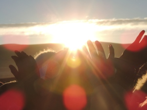 Bolivians welcome the Winter Solstice in Tiwanaku, stretching their open hands towards the New Year's first rays of sun.