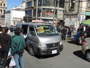 A Trufi toots its way through the streets of downtown La Paz.